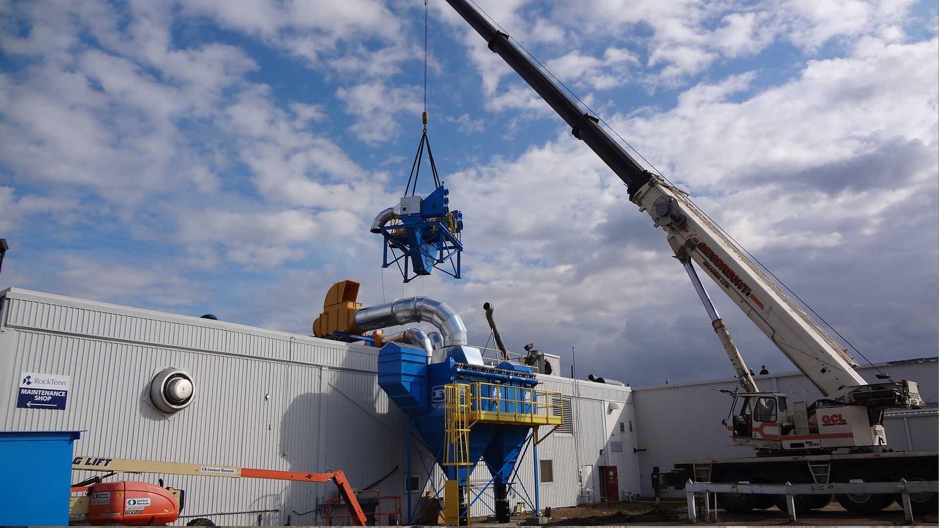 Kernic Systems, using a crane to install equipment