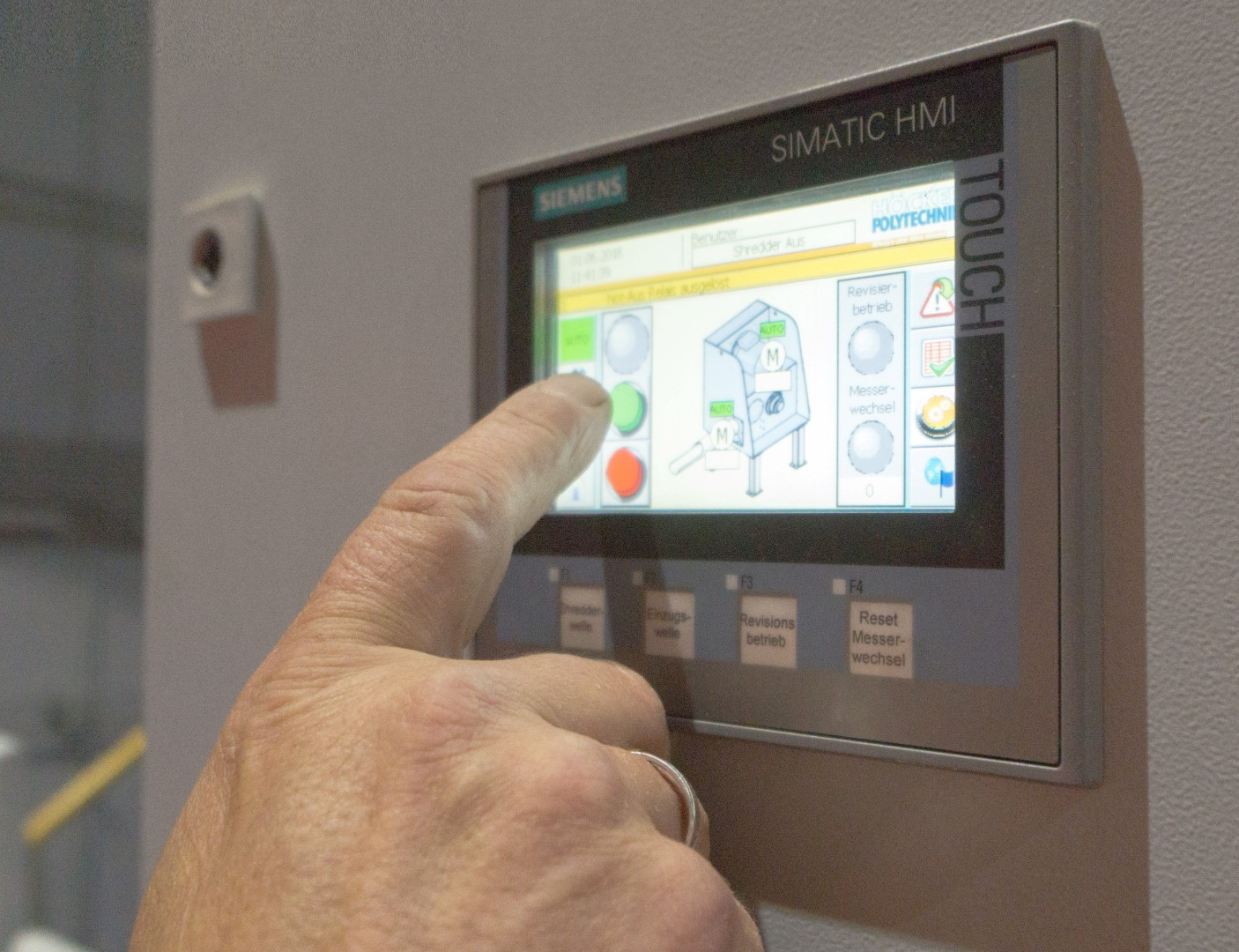 HMI User interface with finger touching the lit up screen